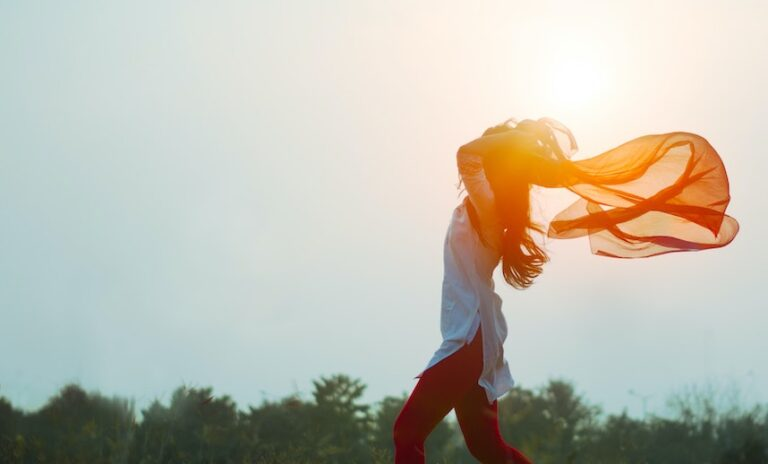 Woman running free, she is happy because she has high self worth and truly loves herself